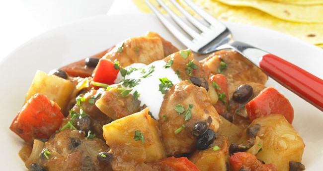 Spicy potatoes with chicken and tomato recipe