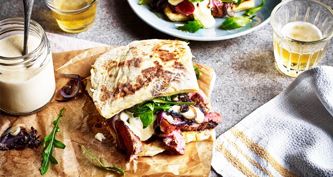 Potato farl steak sandwich with caramelised red onion and cheese sauce