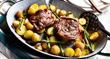 Garlic spring lamb & potato traybake with asparagus